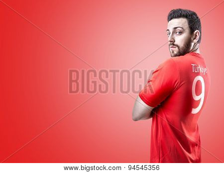 Turkish soccer player on red background
