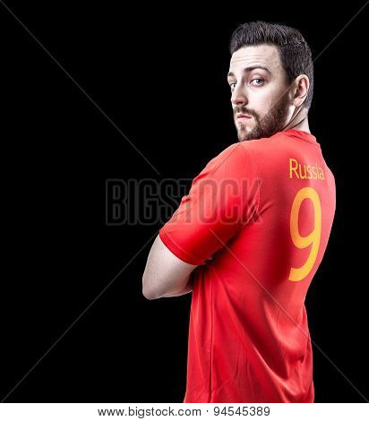 Russian soccer player on black background