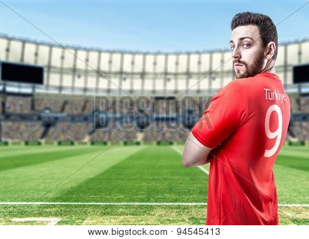 Turkish soccer player in the stadium
