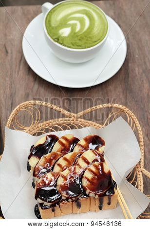 Toast Topped With Bananas And Chocolate - Green Tea With Milk