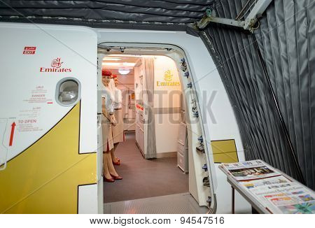 HONG KONG- JUNE 18, 2015: Emirates crew meet passengers on second floor of A380. Emirates is one of two flag carriers of the United Arab Emirates along with Etihad Airways and is based in Dubai