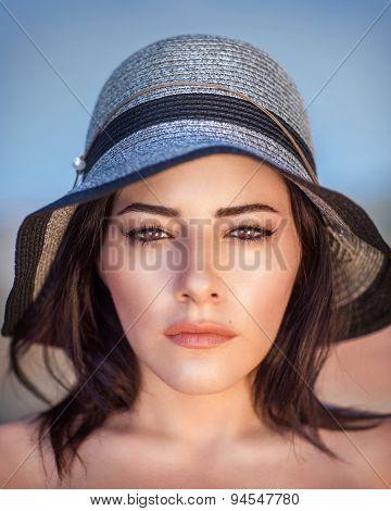 Closeup portrait of beautiful arabic woman wearing stylish sun hat, gorgeous female with perfect makeup outdoors