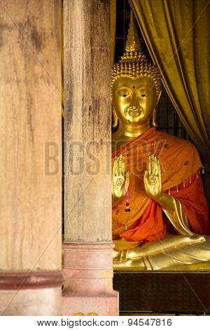 Gold Buddha Statue And Wood Pole