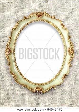 Vintage golden frame on fabric background