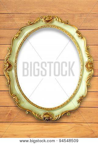 Vintage golden frame on natural wood background