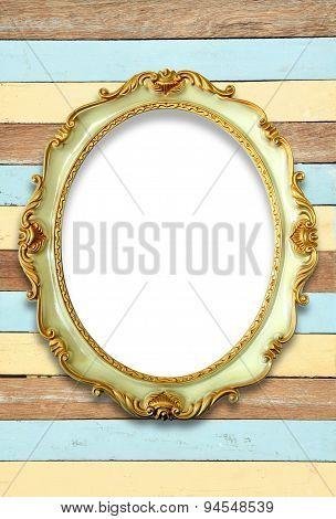 Vintage golden frame on wooden background