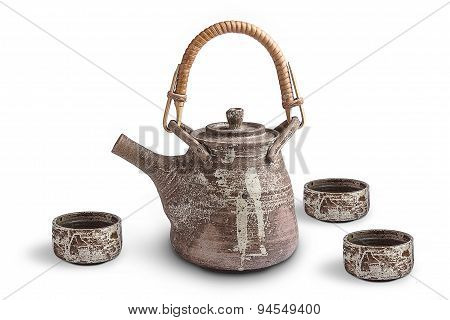 brown ceramic  teapot and cup