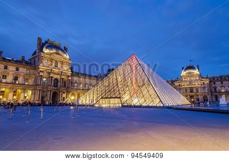 Paris, France - May 14, 2015: Tourist visit Louvre museum at twilight on May 14, 2015 in Paris.