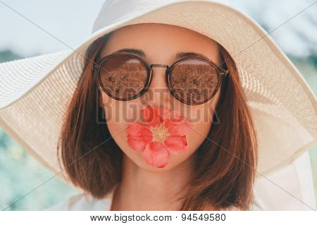 Portrait Of Beauty Woman With Flower