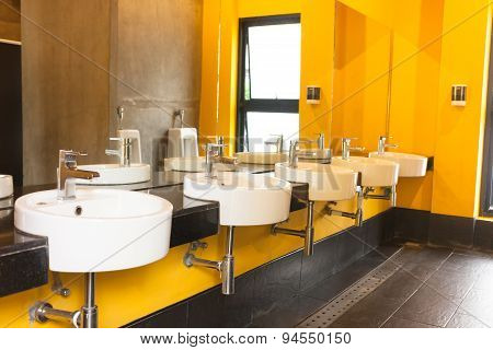 Clean Public Toilet Yellow Colour Room