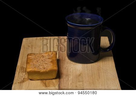 Cup Of Hot Coffee And A Coffee Cake