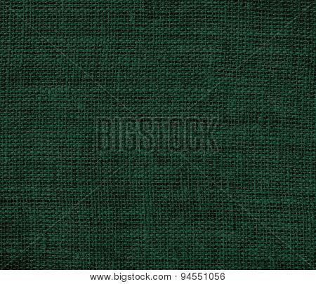 Dark green burlap texture background