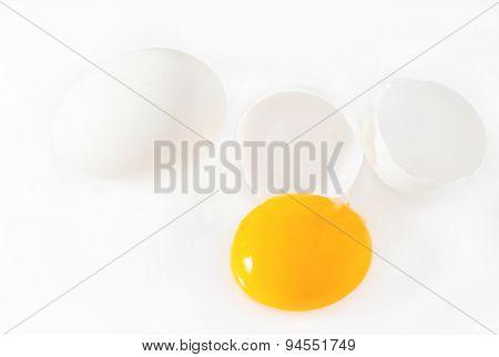 Broken white eggs isolated on white background