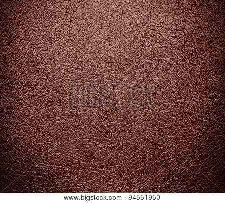 Dark chestnut leather texture background