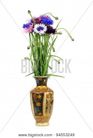 Bouquet Of Cornflowers In A Porcelain Vase