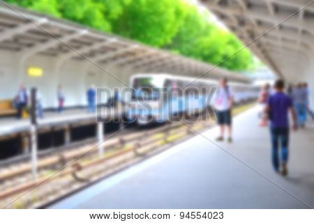 Blurred people on subway platform