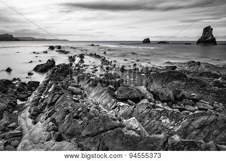 Stunning Tonal Black And White Landscape Of Mupe Bay With Rocks In Foreground
