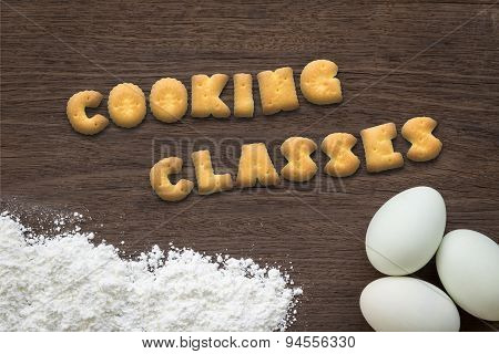 Letter Biscuits Word Cooking Classes On Kitchen Table Background