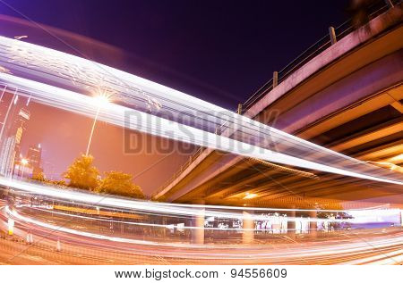 Traffic trails of double decker traveling on a busy road