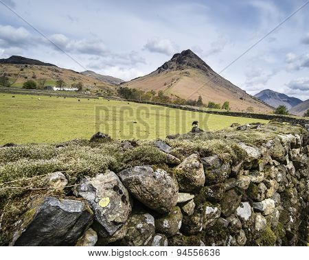 Landscape Of Road Alongside Wast Water In Lake District In England With Mountains In Distance