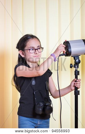 Little girl in a photostudio