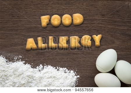 Letter Biscuits Word Food Allergy On Kitchen Table Background