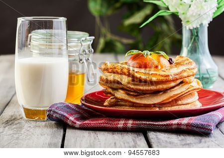 Pancakes With Honey, Fruit And Glass Of Milk