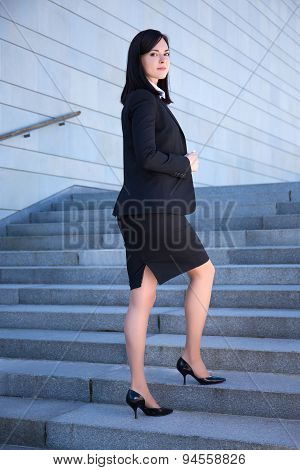 Career Concept - Beautiful Business Woman Standing On Stairs