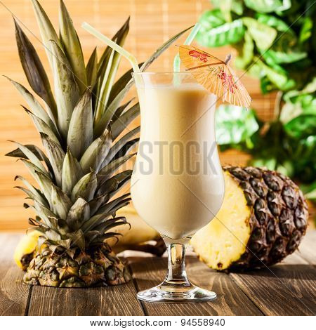 Pina Colada On Wooden Background Garnished Pineapple