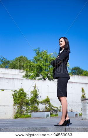 Beautiful Business Woman Standing Over Urban Background
