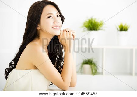 smiling young beautiful woman sitting in living room