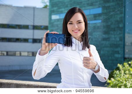 Beautiful Business Woman Showing Smartphone With Blank Screen