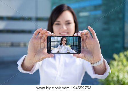 Beautiful Woman Making Selfie Photo On Smartphone