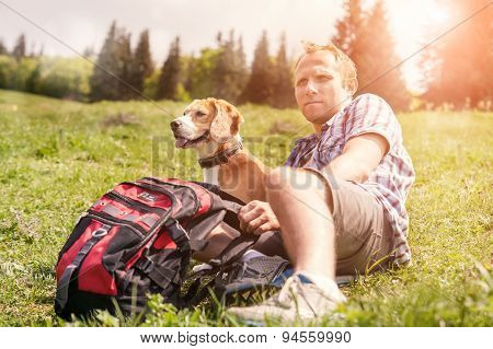 Man With His Dog Rest On The Mountain Hill