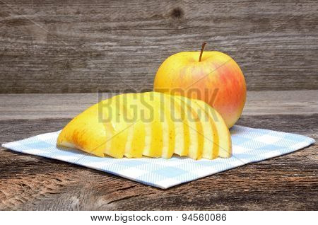 Apple on wooden table