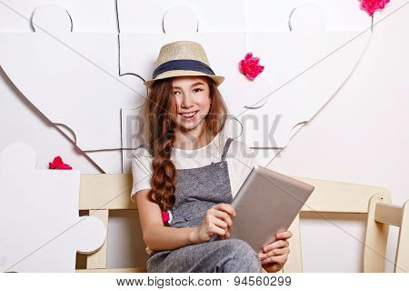 Cheerful Teen Girl With A Tablet