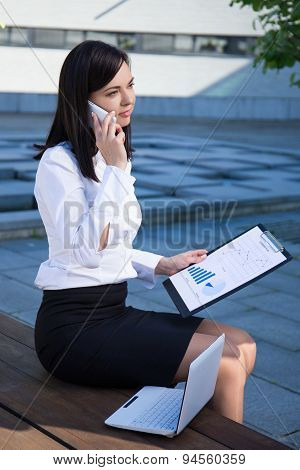 Business Woman Working In City Park