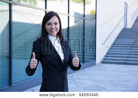 Career Concept - Business Woman Thumbs Up Over Modern City Background