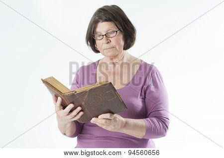 Elderly Woman Reading A Book.