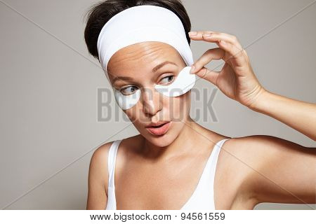 Fun Woman Take Of Facial Eye Patch