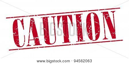 Caution Red Grunge Vintage Stamp Isolated On White Background