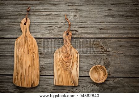 composition with olive wood board on top of oak table, rustic background. Top view.