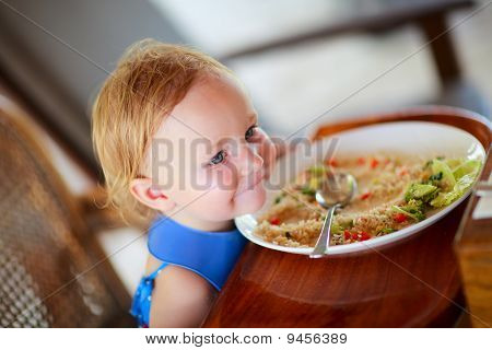 Toddler Girl Eating Lunch