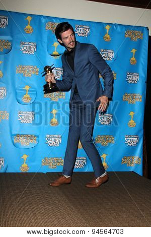 LOS ANGELES - JUN 25:  Grant Gustin at the 41st Annual Saturn Awards Press Room at the The Castaways on June 25, 2015 in Burbank, CA