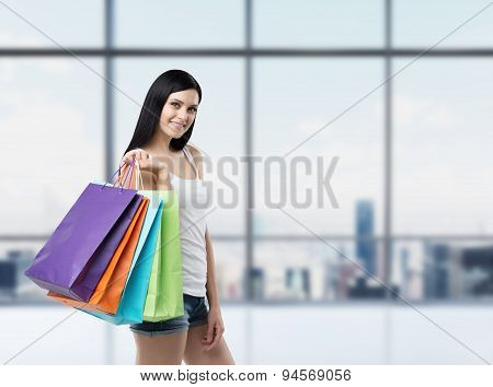Beautiful Smiling Brunette Woman With The Colourful Shopping Bags From The Fancy Shops. New York Pan