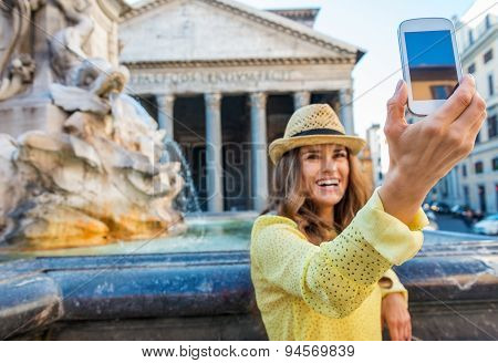Closeup Of Mobile Phone With Smiling Woman Taking Selfie