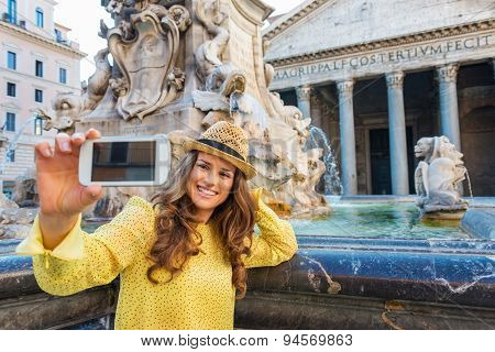 Smiling Woman Tourist Taking Photo At Pantheon Fountain In Rome