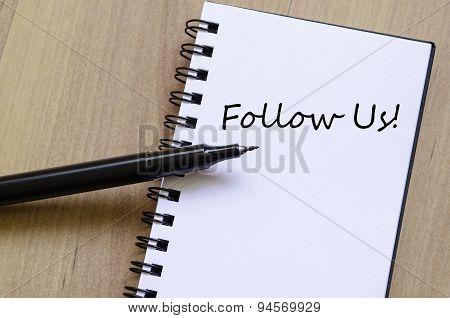 Follow Us Concept Notepad