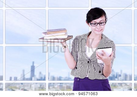 Smiling Businesswoman Using Tablet Pc