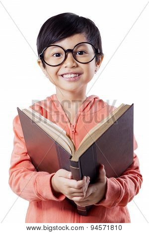 Sweet Elementary School Student Reads Book